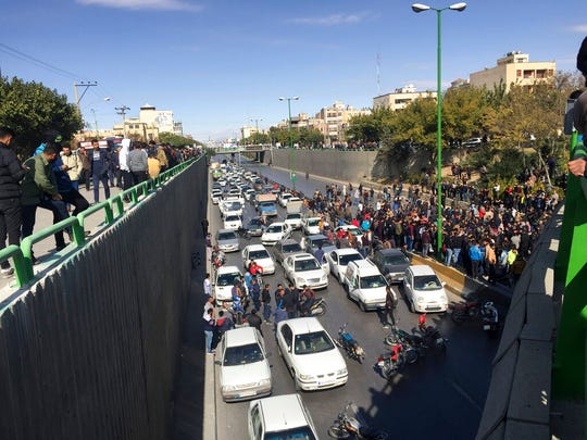 Cars block a street during a protest against a rise in gasoline prices, in the central city of Isfahan, Iran, Saturday, Nov. 16, 2019. Demonstrators angered by a 50% increase in government-set gasoline prices blocked traffic in major cities and occasionally clashed with police Saturday after a night of demonstrations punctuated by gunfire.