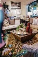 If your holiday display is simple, have some fun with the rest of the room by tying in fun fabrics like plaid, leopard and houndstooth in the furniture and flooring.