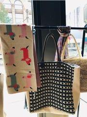 Fair-trade, handmade purses and children's blankets sold at The Rumjahn Gallery and Framery