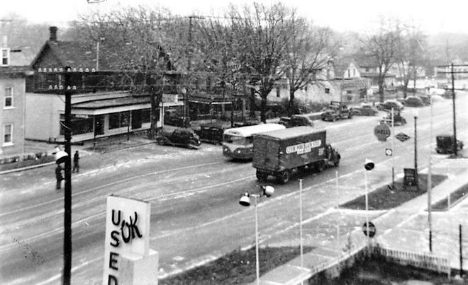 This 1950s photograph shows a variety of traffic in the 200 block of East State Street.