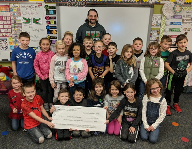 Second Grade students at Bataan Memorial Primary Elementary presented the local Wreaths Across America committee, Nathan Holman, with a $237 donation.