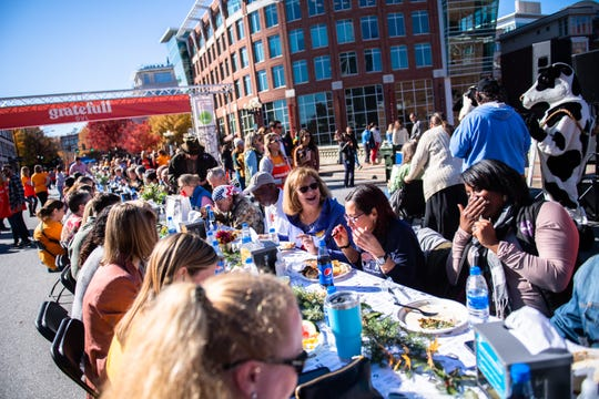 Thousands of people descended on the Main Street bridge for the first annual Gratefull GVL potluck meal, Monday, November 25, 2019, from 11 am to 1:30 pm.