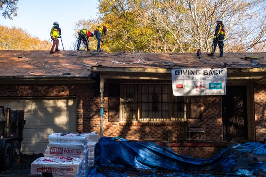Workers from Guy Roofing work on installing a new roof at the home of Bobby Hogan, an Army veteran who served from 1980-1992, who has received a donated new roof from Owens Corning , Monday, November 25, 2019.