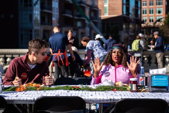 Mark Brewton, of Greenville and Delores Sullivan, of Piedmont, share conversation at the first annual Gratefull GVL potluck meal which drew thousands, Monday, November 25, 2019, from 11 am to 1:30 pm.