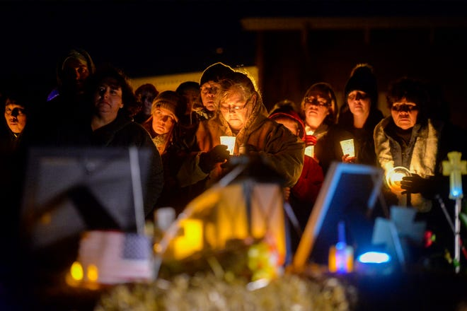 A few hundred people attended a candlelight vigil to remember five-year-old Antonio Renova Sunday night in front of the apartment complex at 1201 9th Street N.W., November 24, 2019.