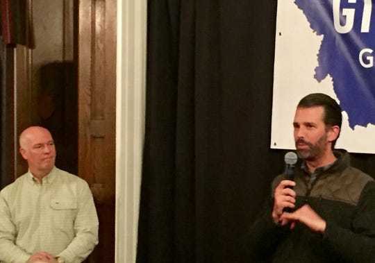 Greg Gianforte, left, watches as Donald Trump Jr. speaks Sunday at the Montana Club. Trump Jr. said he was able to do some hunting while visiting the state.