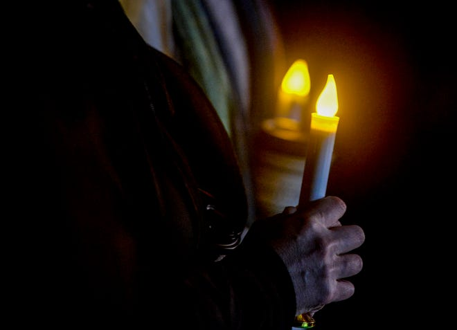 A candle light vigil to remember five-year-old Antonio Renova is held on Sunday night in front of the apartment complex at 1201 9th Street NW, November 24, 2019.  Court documents say Renova was found dead Wednesday, Nov. 20, in the apartment he was living at with his parents. His parents, Emilio Emmanuel Renova Sr. and Stephanie Grace Byington, and another man at the residence, Racso James Birdtail, have all been charged with deliberate homicide.