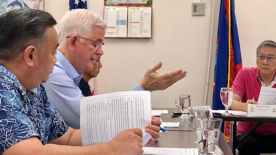 Guam Election Commission member Patrick Civille gestures as he addresses other commissioners led by Chairman Mike Perez, right, during a meeting on Nov. 25, 2019. The Monday night meeting included approval of the format of a petition to recall Yona Mayor Jesse Blas, who's been in federal detention since September.