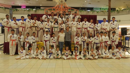 Noly Caluag, chief instructor of Guam Taekwondo Center is shown with his wife, Malu Caluag and the medalists during the closing ceremonies of the fifth Master Noly's martial arts weapons and tile breaking tournament held Nov. 16 at Micronesia Mall. A total of 100 martial artists as young as four years old competed in this dual tournament.  Notable performances came from weapons gold medalists: Ryan Gaza, Gable De Chavez and Liam Laguana.  Gold medal performances for the breaking included: Tyler Wang, Sophie Uygioco, Evin Aguon, Maya Torre, JJ Chen, Kristian Fernandez, Nathan Matienzo, Thyra Villanueva and Kevin Fernandez.