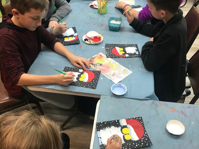 Gifted students work on their art projects recently in Henderson.