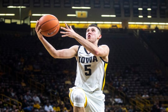 Iowa guard C.J. Frederick (5) drives to the basket for a layup during a NCAA non-conference men's basketball game, Sunday, Nov. 24, 2019, at Carver-Hawkeye Arena in Iowa City, Iowa.
