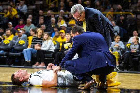 Iowa head coach Fran McCaffery checks on Iowa forward Jack Nunge (2) during a NCAA non-conference men's basketball game, Sunday, Nov. 24, 2019, at Carver-Hawkeye Arena in Iowa City, Iowa.