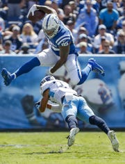 Indianapolis Colts tight end Eric Ebron (85) hurdles Tennessee Titans defensive back Amani Hooker (37) in the first quarter of their game at Nissan Stadium in Nashville, Tenn., on Sunday, Sept. 15, 2019.