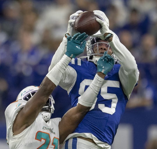 Indianapolis Colts tight end Eric Ebron (85) hauls in a catch as he is defended by Miami Dolphins cornerback Eric Rowe (21), Miami Dolphins at Indianapolis Colts, Sunday, Nov. 10, 2019. Colts lost 16-12.