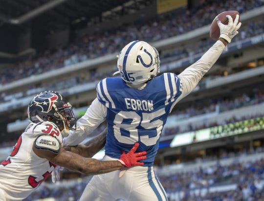 Eric Ebron of the Indianapolis Colts grabs a one-handed touchdown as he is defended by Lonnie Johnson of the Houston Texans in Indianapolis on Oct. 20, 2019, at Lucas Oil Stadium.