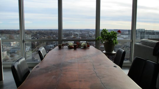 The dinning room table in the 14th floor apartment of Norm Cate and Deb Ely, located in the Chauncey Building.
