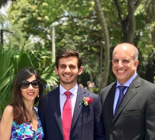 Antonio Tsialas and his parents, Flavia and John Tsialas.