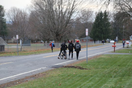 Dewitt Middle School Students walk on Winthrop Drive in the Town of Ithaca.