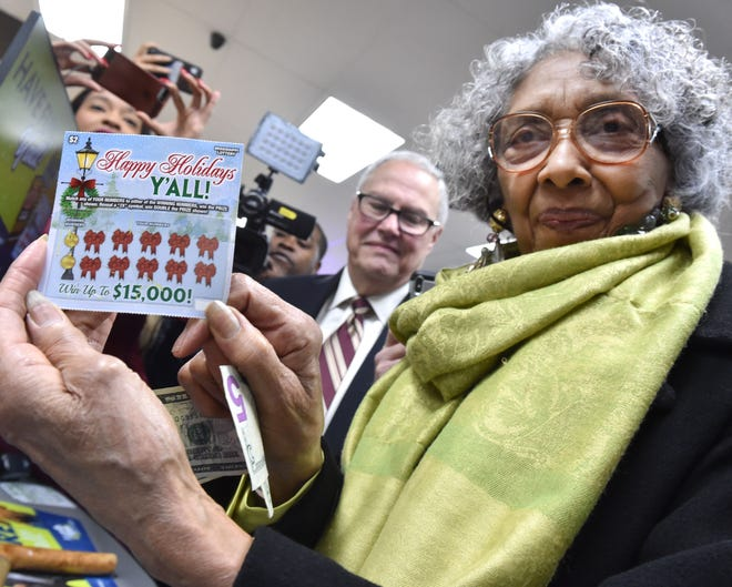 Mississippi State representative Alyce G. Clarke of Hinds County purchased a first scratch off lottery game sold early on Monday, Nov.25, 2019 at the RaceWay on Mississippi Highway 18 in south Jackson.