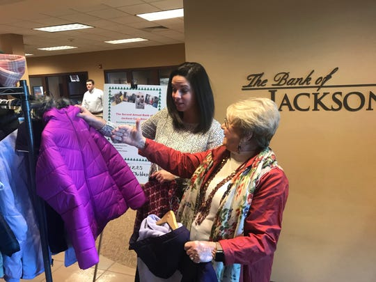 Elizabeth Bryant and Anita Kay Archer sort through coats already collected at Bank of Jackson for the Washington Douglas Head Start/Early Head Start coat drive.