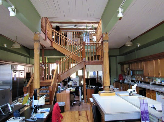A look inside the old general store shows the staircase going up to another work area on the second floor. It was designed by Switzer several years ago. He kept architectural elements like the ceiling but restructured the original roof to include skylights.