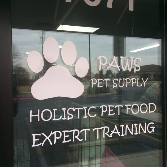 Paws offers grooming services, training and holistic pet food.