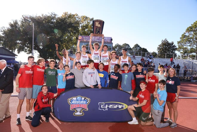 Teurlings Catholic's boys cross country program poses for pictures after winning the Class 4A state championship.