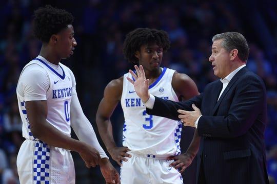 UK G Ashton Hagans and G Tyrese Maxey listen to head coach John Calipari during the University of Kentucky basketball game against Lamar at Rupp Arena in Lexington, KY on Sunday, November 24, 2019.