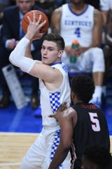 UK G Nate Sestina controls the ball during the University of Kentucky basketball game against Lamar at Rupp Arena in Lexington, KY on Sunday, November 24, 2019.