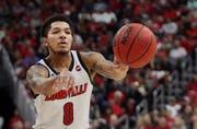 "Louisville's Lamarr ""Fresh"" Kimble passes the ball up court against Akron on Nov. 24, 2019."