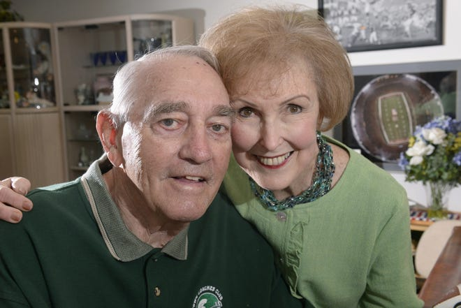 Hank Bullough, patriarch of MSU football's first family with his wife, Lou Ann Bullough, at home in 2014 surrounded by just some of the football memorabilia from his MSU and pro football life.