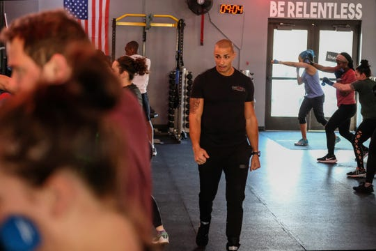 Brian Daniels, co-owner of EmPOWer gym, teaches a class on Saturday, Nov. 23, 2019.