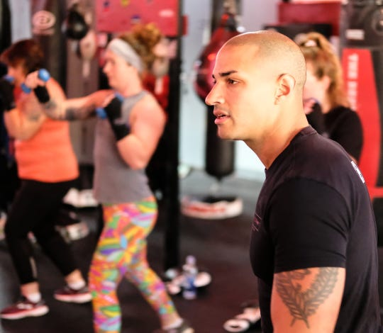 Brian Daniels, co-owner of EmPOWer gym teaches a class on Saturday, Nov. 23, 2019.