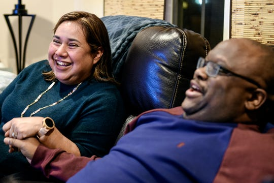 Kobie Johnson, right, and his wife Diane Cardenas-Johnson share a light-hearted moment while discussing health emergency on Wednesday, Nov. 20, 2019, at Johnson's home in East Lansing.