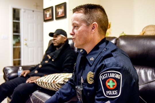 East Lansing Police Sgt. Erich Vedder talks about helping save Kobie Johnson's life on Wednesday, Nov. 20, 2019, at Johnson's home in East Lansing. Johnson suffered a cardiac arrest in his vehicle on Sept. 26 while on Burcham Drive.