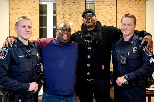 Kobie Johnson, second from left, poses with, from left, East Lansing Police Officer Andrew Stephenson, Aurelio Todd and East Lansing Police Sgt. Erich Vedder on Wednesday, Nov. 20, 2019, at Johnson's home in East Lansing. Johnson was saved by the three men after suffering a cardiac arrest while in his car on Burcham Drive on Sept. 26.
