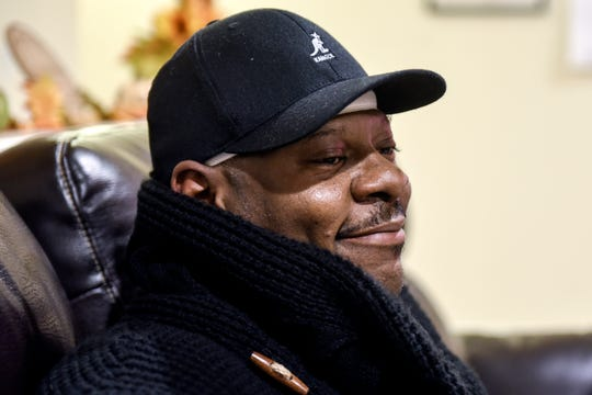 Aurelio Todd smiles at Kobie Johnson while talking about helping to save Johnson's life on Wednesday, Nov. 20, 2019, at Johnson's home in East Lansing. Johnson suffered a cardiac arrest in his vehicle on Sept. 26 while on Burcham Drive. Sergeant Vedder, two other East Lansing Police officers and Todd helped save Johnson.