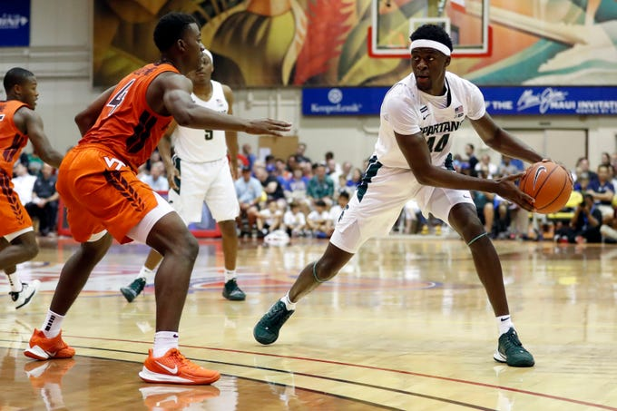 Michigan State forward Gabe Brown (44) tries to get around Virginia Tech guard Nahiem Alleyne (4) during the first half of an NCAA college basketball game Monday, Nov. 25, 2019, in Lahaina, Hawaii. (AP Photo/Marco Garcia)