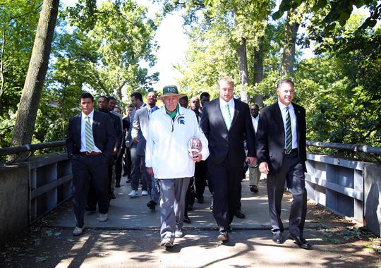 Sep 14, 2013; East Lansing, MI, USA;  Michigan State Spartans head coach Mark Dantonio walks with his team, alongside Max Bullough and Henry Bullough, from Kellogg Center to Spartan Stadium prior to a game against the Youngstown State Penguins  at Spartan Stadium. Mandatory Credit: Mike Carter-USA TODAY Sports