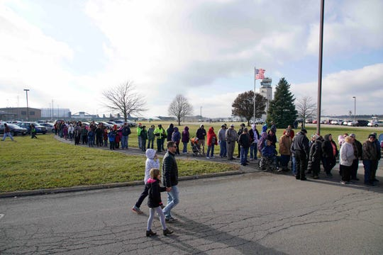 """The line stretched out the door at Mansfield Lahm Regional Airport to get an autograph from astronaut Douglas Harry """"Wheels"""" Wheelock."""