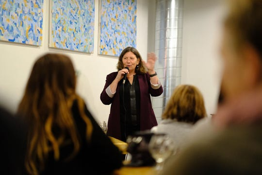 Psychologist Julie Helmrich answers questions during Shrink 'n' Drink each month at Vennture Brew Co.
