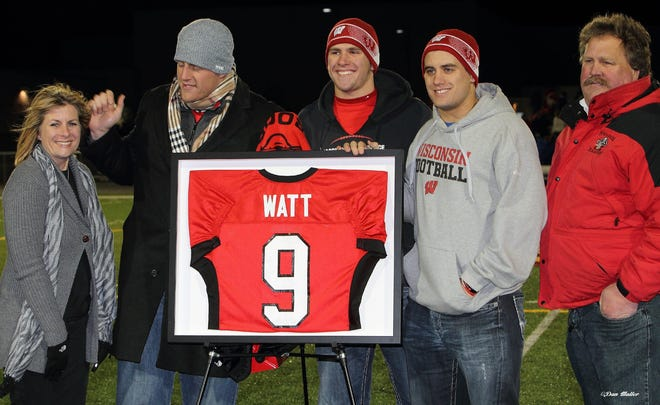 Pewaukee High School retired J.J. Watt's No. 9 Pirates jersey on Oct. 25, 2013 during a varsity playoff game against Elkhorn. Among those on hand were (from left) mom Connie, J.J., brothers T.J., Derek and father John.