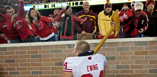 Bradie Ewing and the Wisconsin Badgers hold onto to the Paul Bunyan Axe following the win over the Gophers.  The Wisconsin Badgers defeated the Minnesota Gophers 42-13 at TCF Stadium in Minneapolis MN Saturday November 12, 2011.