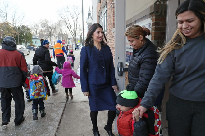 Laura Gutiérrez, Associate Executive Director at the United Community Center, holds the door open as the younger students leave for the day. She will soon be leading the organization.