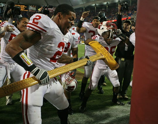 "Wisconsin linebacker Jonathan Casillas (2) ""cuts"" down the goal post with Paul Bunyan's axe after Wisconsin's 41-34 win over Minnesota Saturday, November 17, 2007."