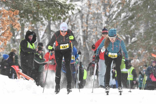 Classic skiers race in the Forest Frenzy winter triathlon in Boulder Junction in 2019.