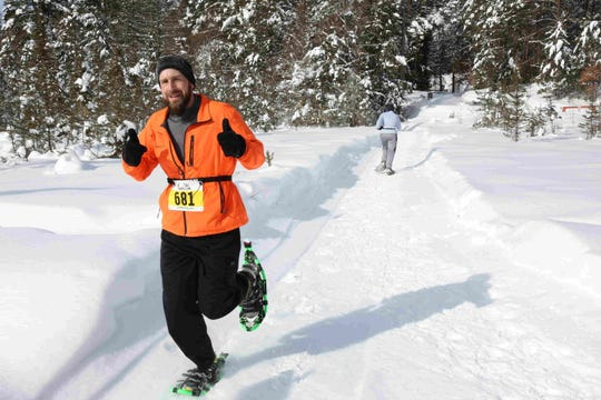 Participants tackle the snowshoeing leg of the Forest Frenzy winter triathlon in Boulder Junction in 2019.