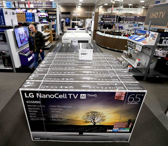 The aisles are filled with various large-screen televisions for sale at at Best Buy in Brookfield.