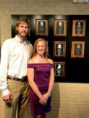 Mountain Home native Olivia Fisher-Bickford, pictured with her husband Jared, was recently inducted into the University of the Ozarks Sports Hall of Fame.