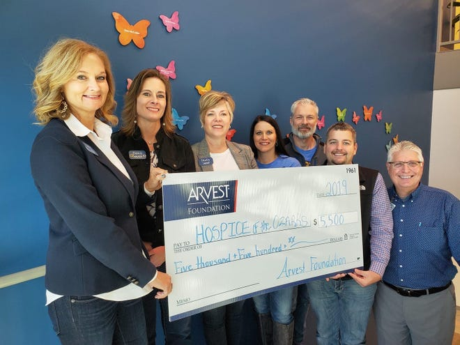 At Arvest Bank's donation presentation at the Hospice of the Ozarks were (left to right) Sally Gilbert, Dawn Cotter, Shelly Hill, April Fowler, Kyle Davidson, Zack Lashley, and Greg Wood.